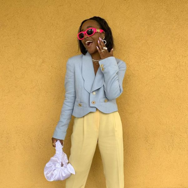 nxcv.a wearing pastel blue blazer and yellow suit trousers