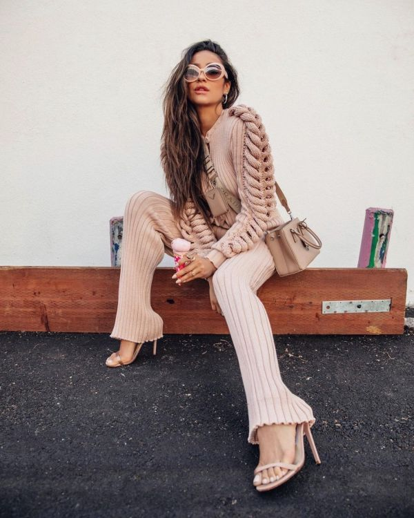 Shay Mitchell wearing a pair of 70s-inspired sunglasses