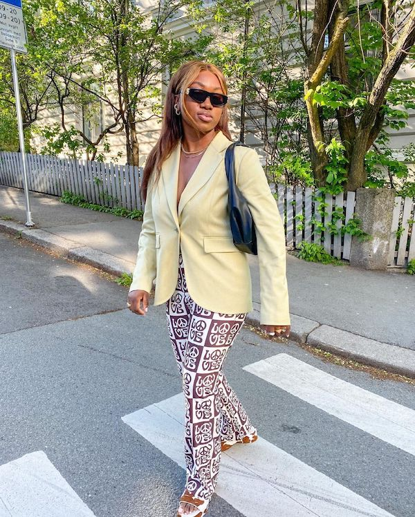 nnennaechem wearing house of sunny trousers and pastel yellow blazer