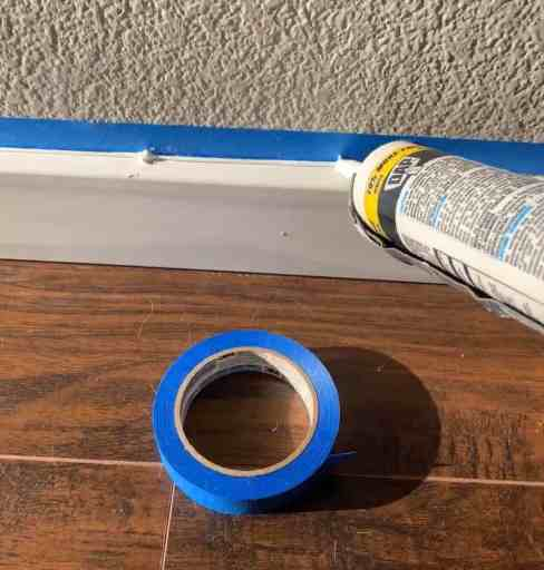tape and caulk trick for crisp caulk lines