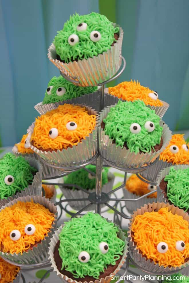 Green and orange monster cupcakes with eyes
