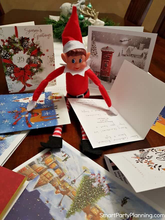 Elf on the Shelf reads Christmas cards