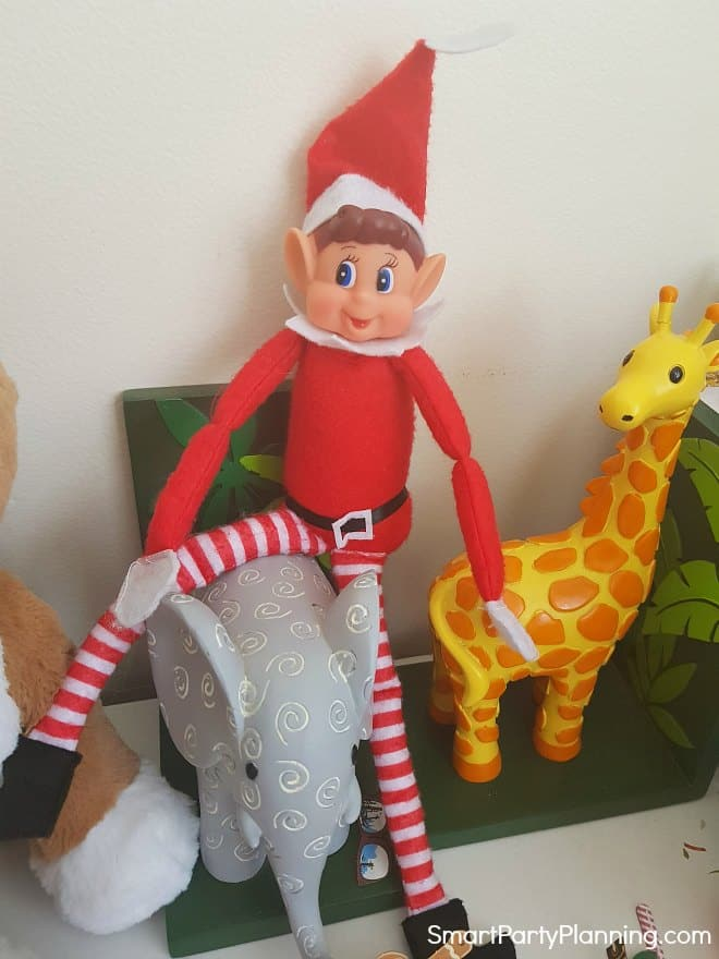 Elf on the Shelf sitting on a bookend