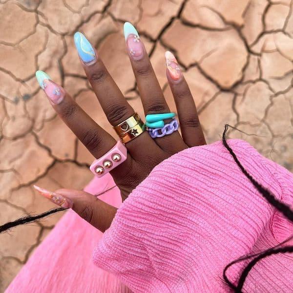 AJ from @nxcv.a wearing resin rings