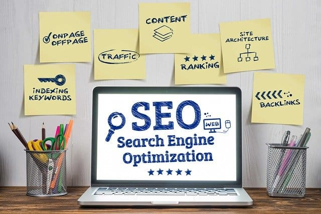 search engine optimization on a laptop sceen with post-its around it