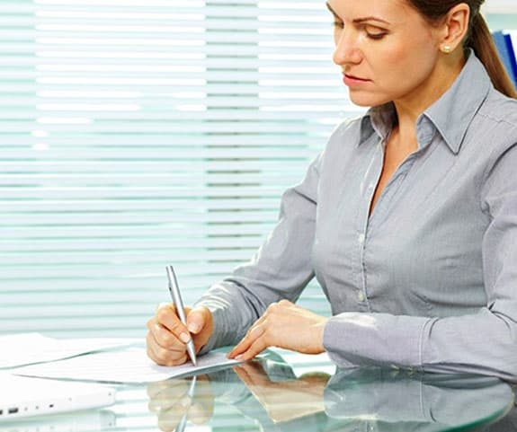 signing-documents-woman-office.jpg