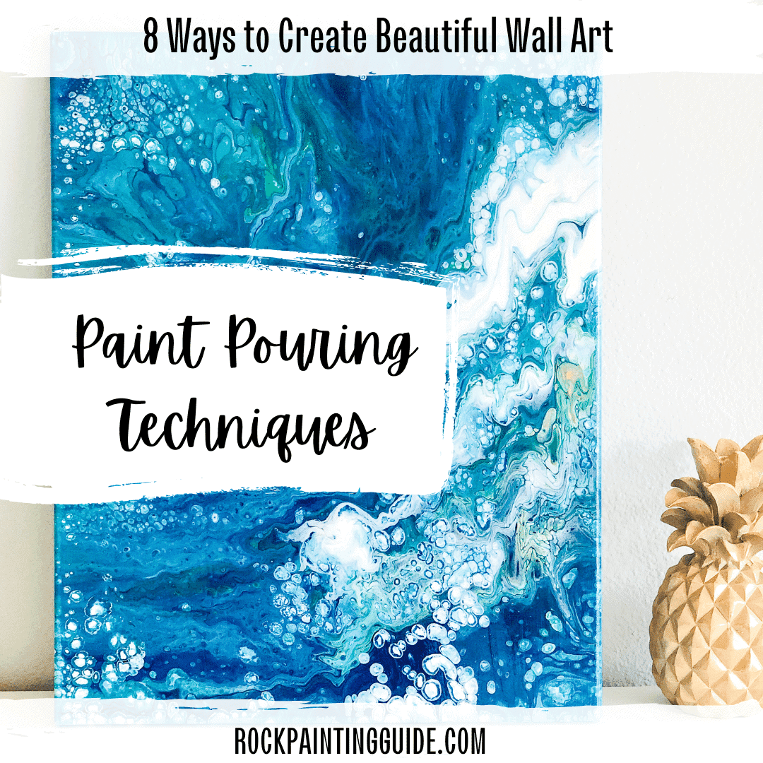 paint pouring techniques wall art with blues and greens and gold pineapple on a table