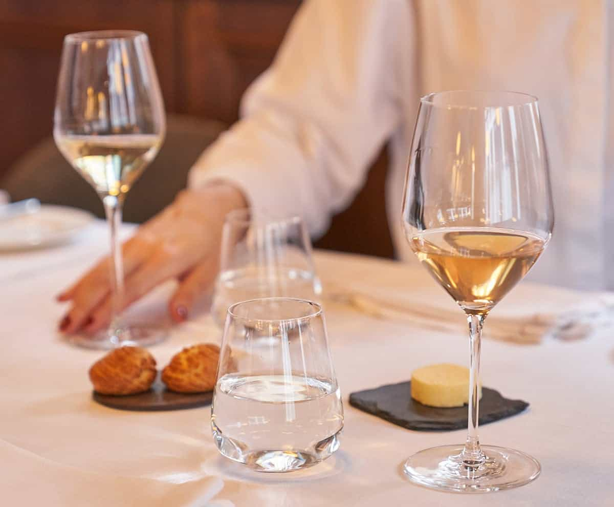 White wine served with a couple of pastries