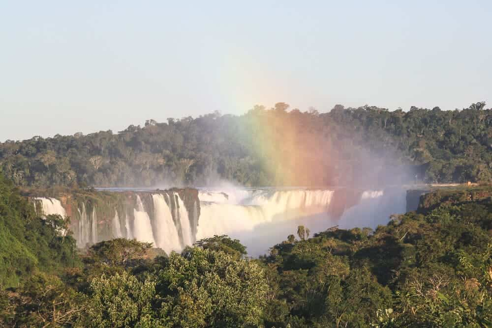 A rainbow in the mist over a waterfall