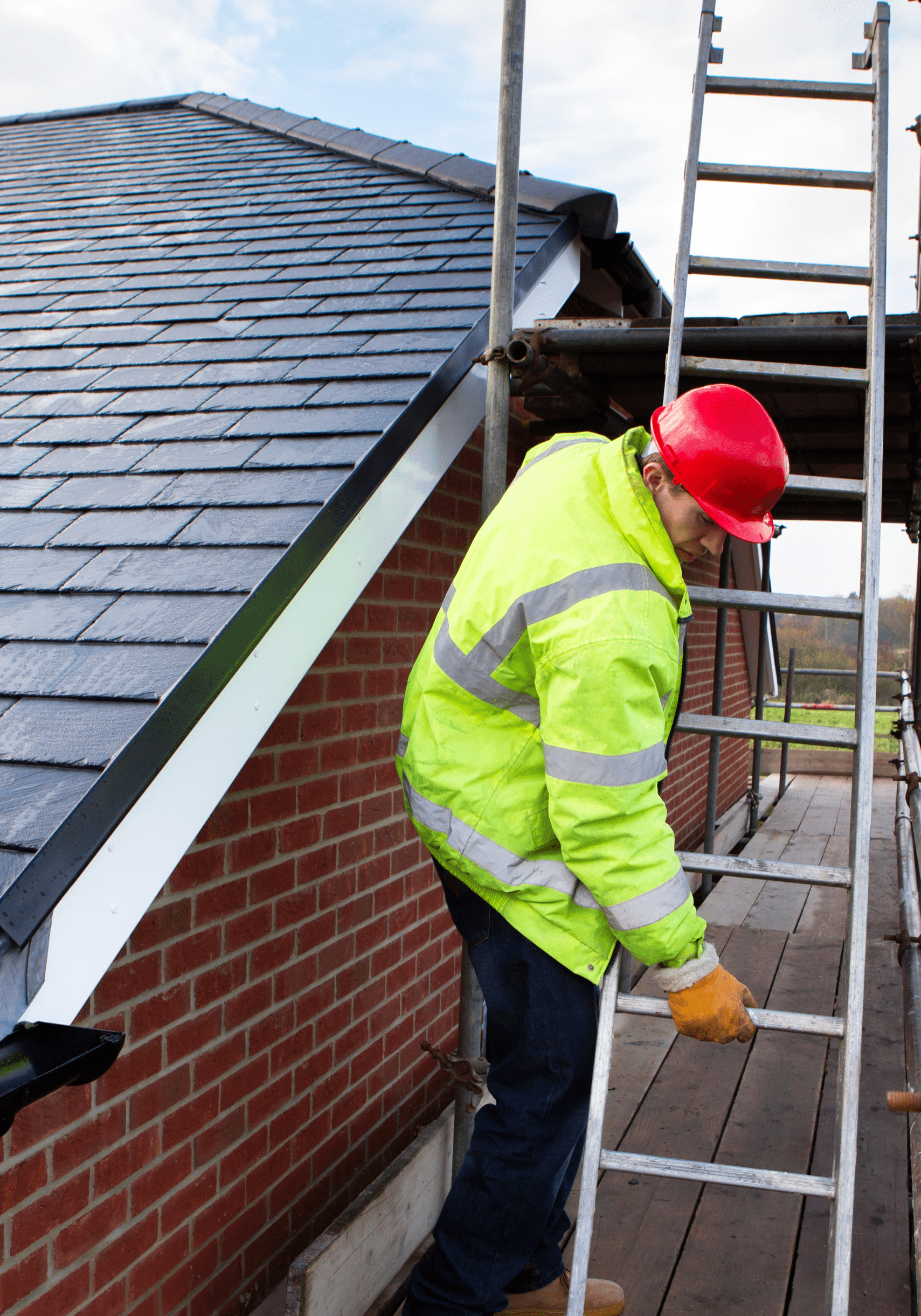 roofer with ladder by roof