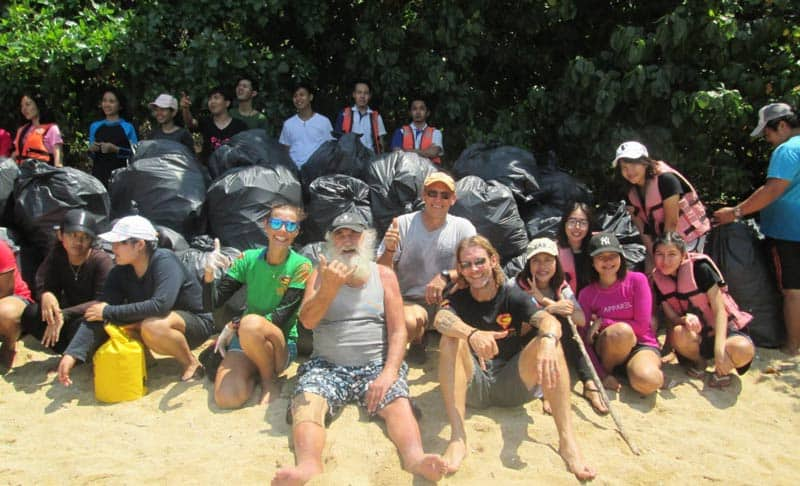 John Gray Sea Canoe beach clean up with Super Divers
