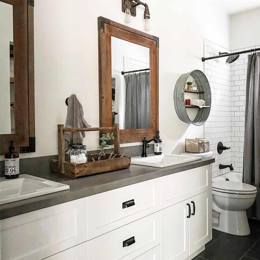 rustic farmhouse bathroom cabinet idea with concrete countertop and subway tiles