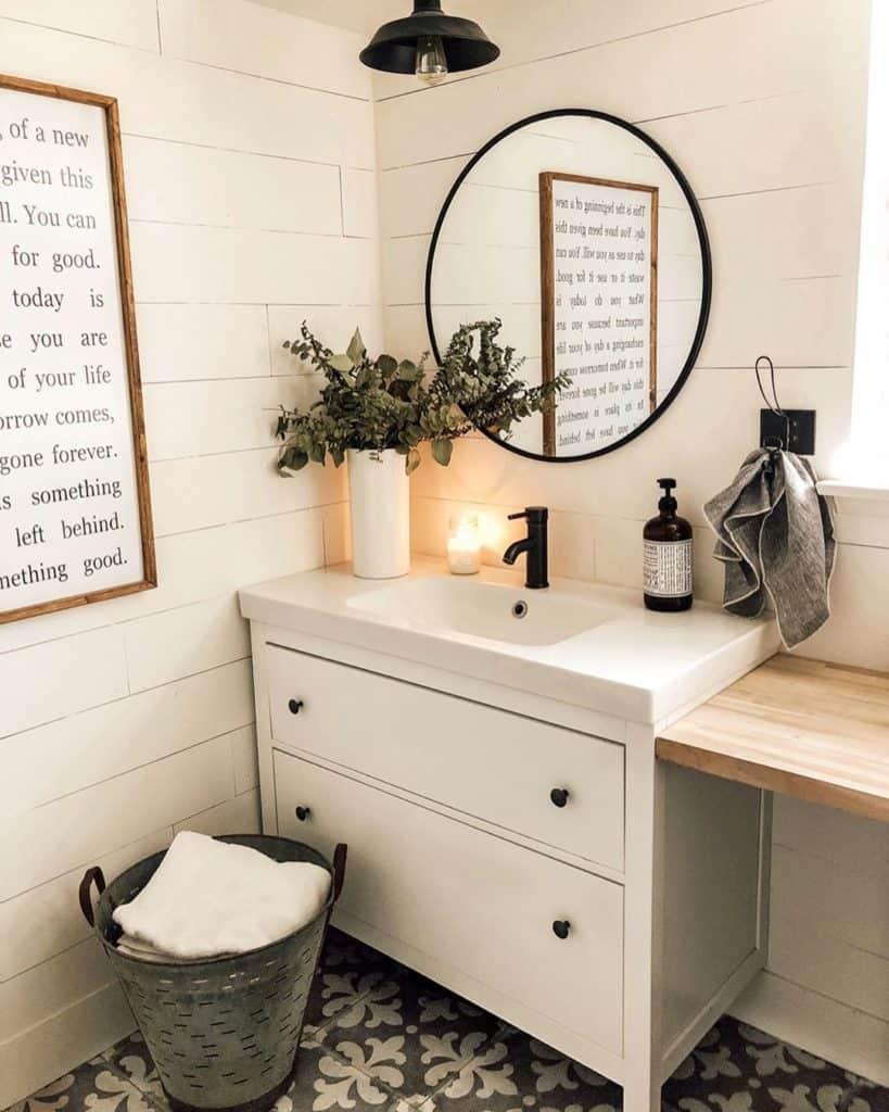 bathroom cabinet idea in farmhouse bathroom with shiplap