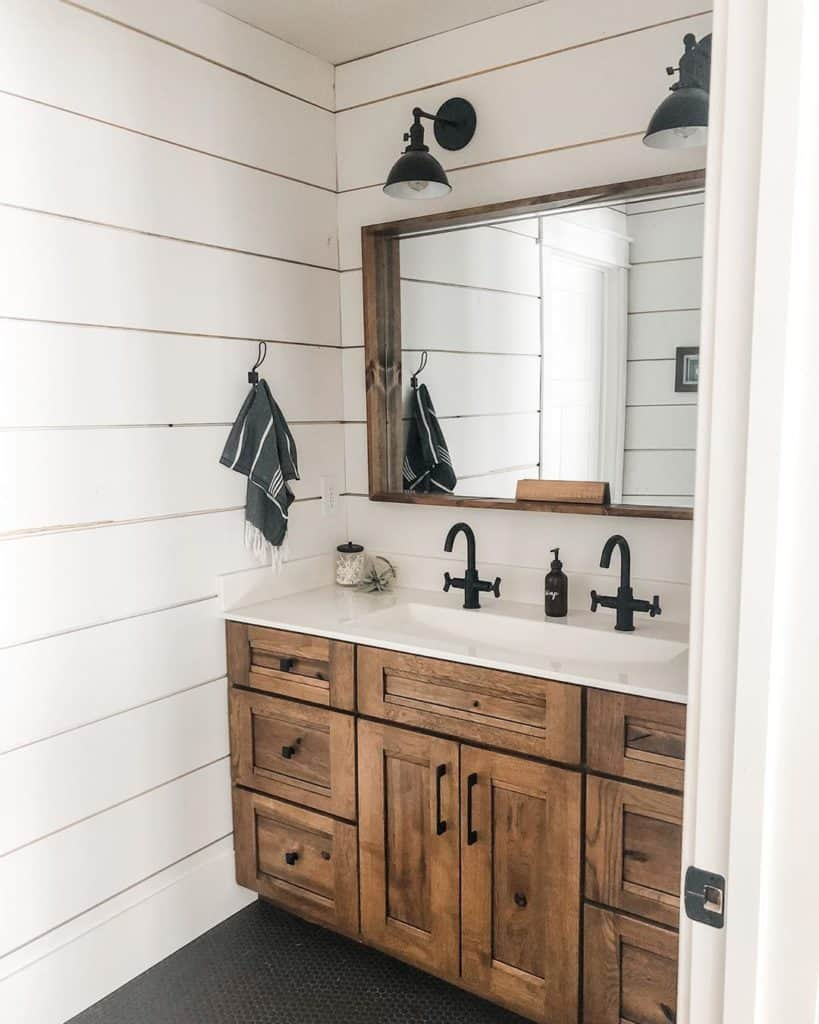 rustic farmhouse bathroom cabinet idea with shiplap walls and charcoal floor