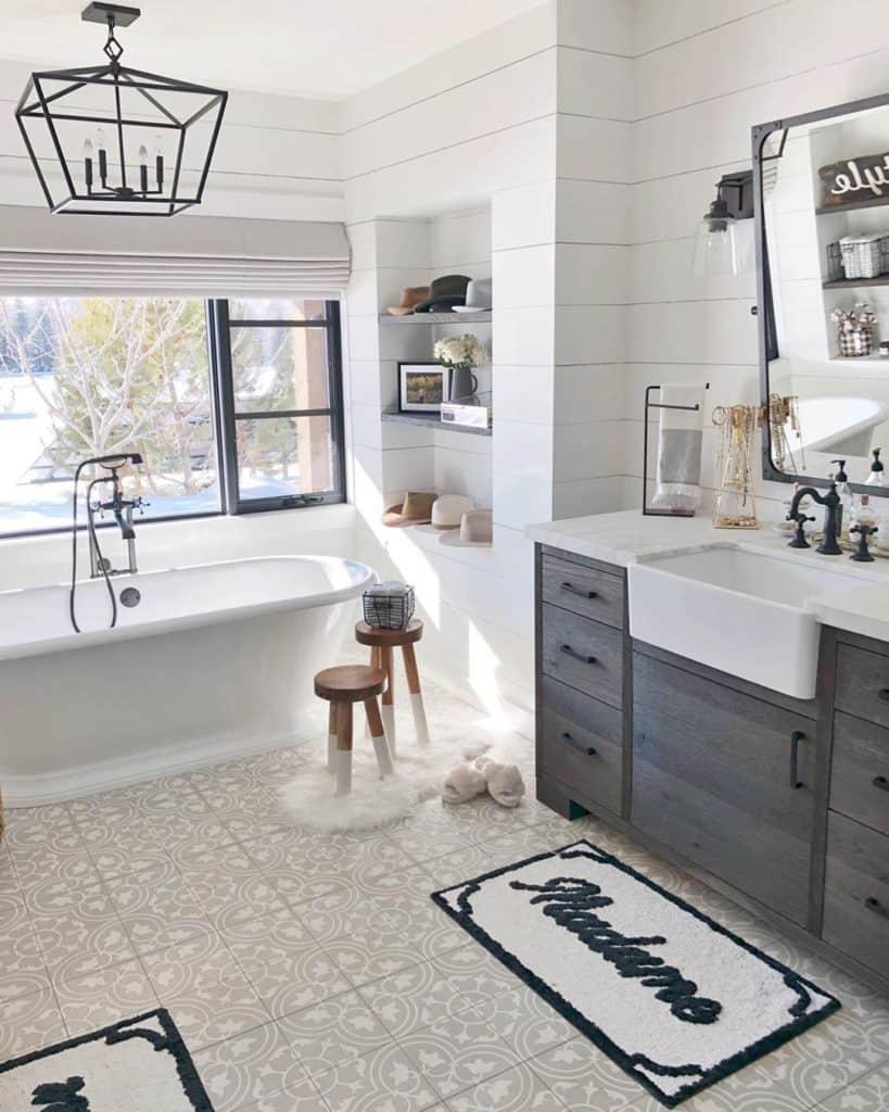 coastal farmhouse bathroom with oak bathroom cabinet idea and matte black bathroom fixtures hardware