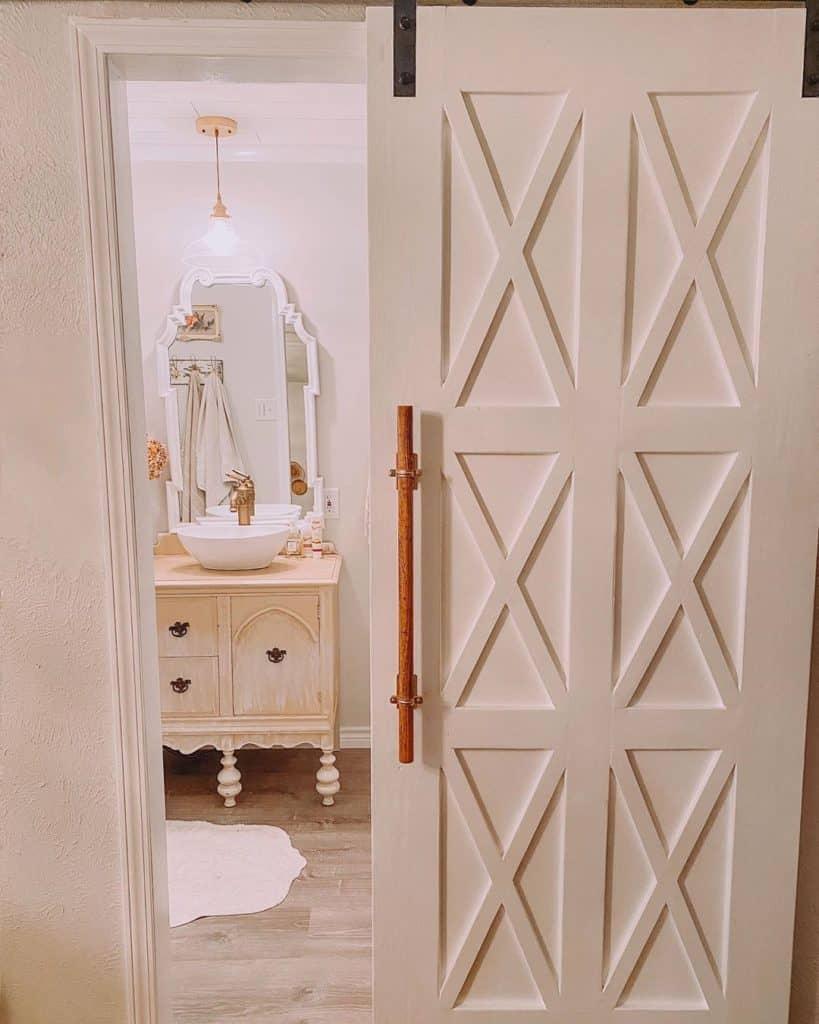 white and pink shabby chic barndoor bathroom cabinet idea