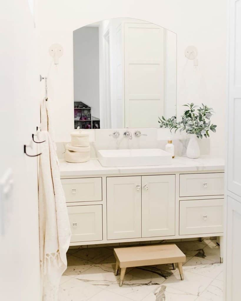 bathroom cabinet ideas with cream colored bathroom and children knobs