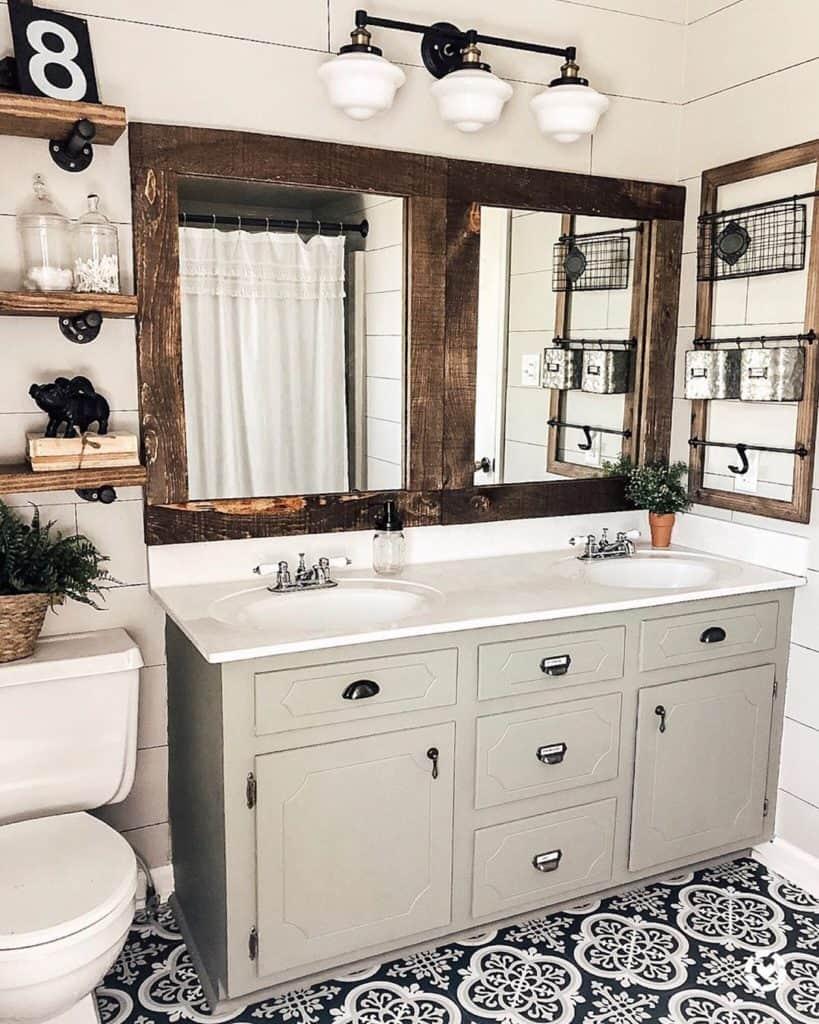 farmhouse bathroom with grya vanity and rustic mirrors