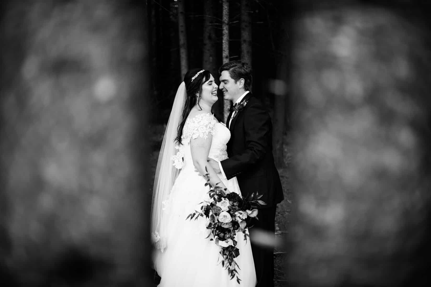 black and white bride and groom portrait in forest