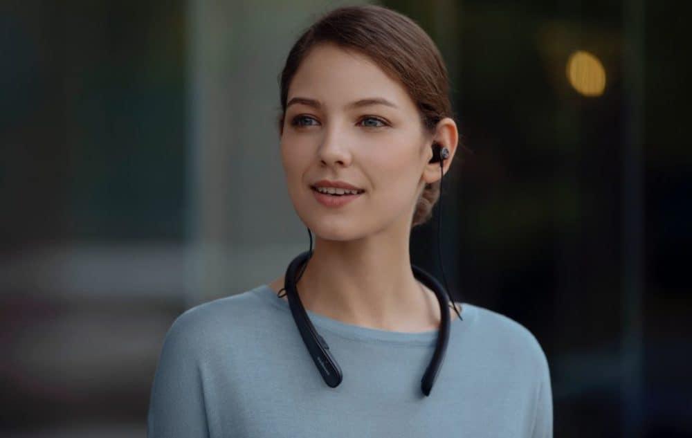 Women wearing Life NC headphones
