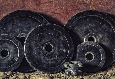 pictures of black, iron weights, symbolizing Bodybuilding progress