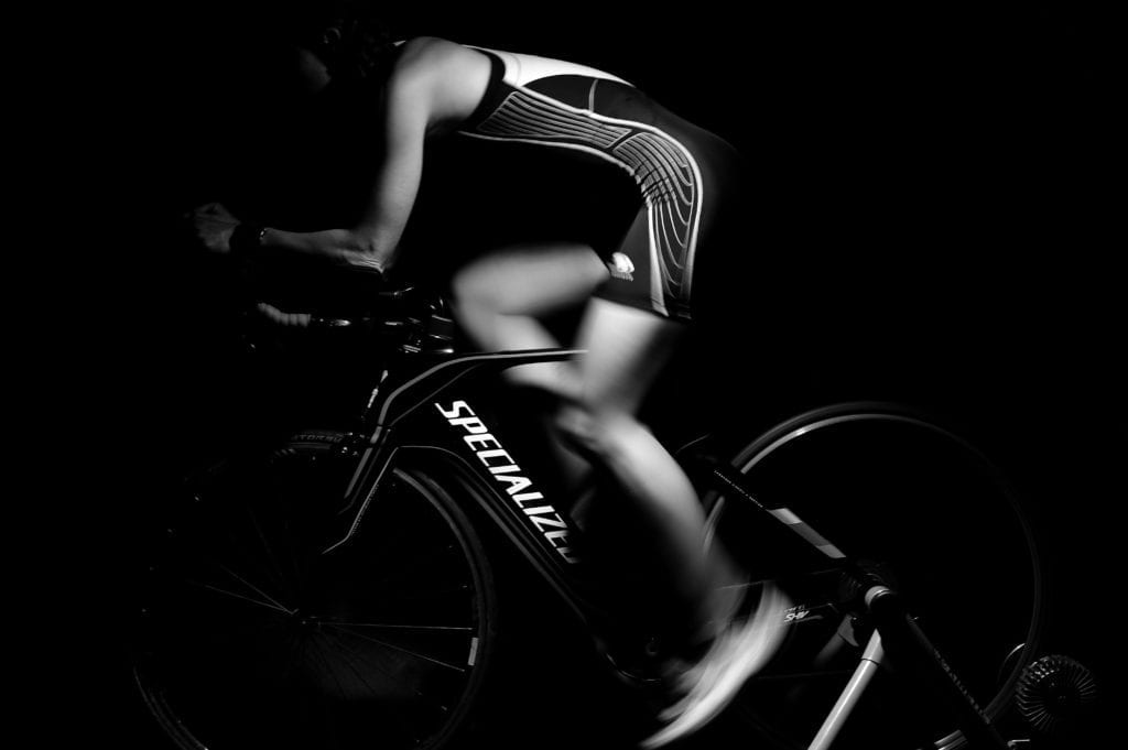 A male on a bike performing a cardio workout