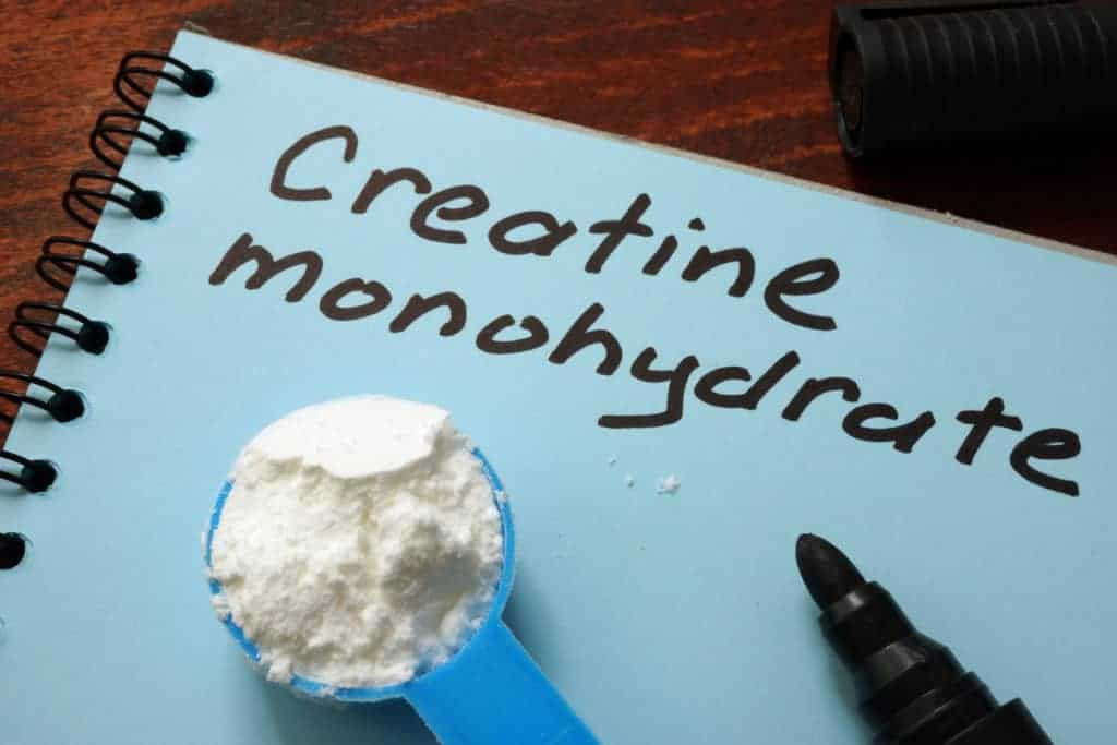 a notebook with creatine monohydrate written on it