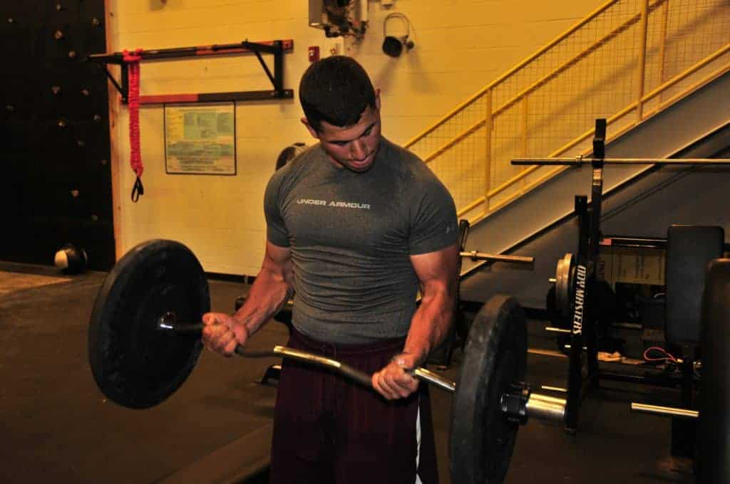 A young bodybuilder doing arm curls