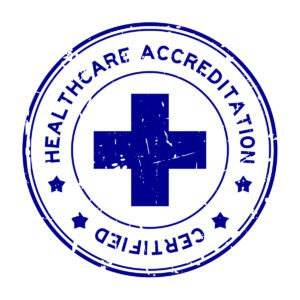 Grunge blue healthcare accreditation round rubber seal stamp on white background referring to legal all natural steroids being safe to use