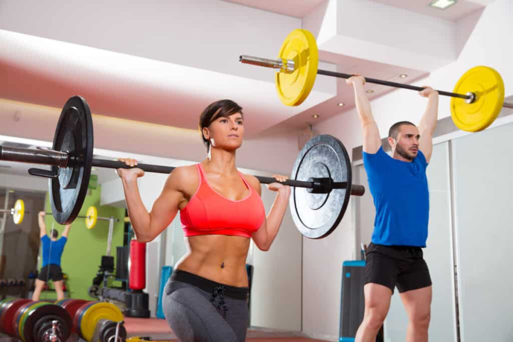 a man and a woman combining running and weightlifting into their fitness routine