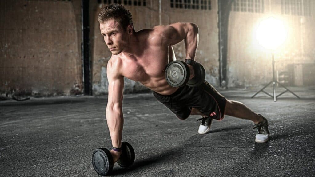a youg fitmale doing a full body work out making sure to worout all of his muscles equally