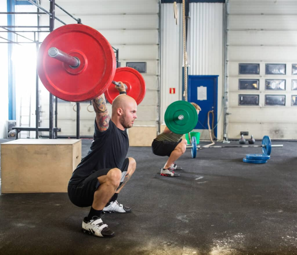 olympic wight lifters training with the deadlift referring to the old debate is powerlifting vs weightlifting