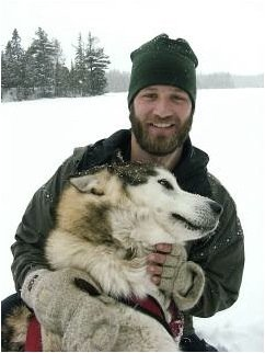 Dave Freeman with a sled dog named Tundra