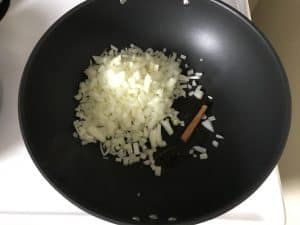 Onion and cinnamon stick to frying pan