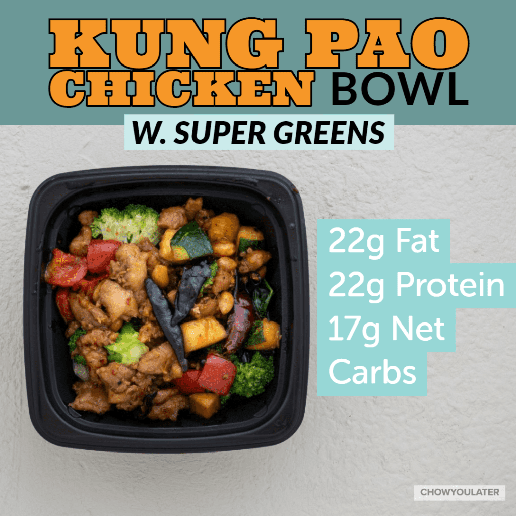 keto kung pao chicken bowl with super greens on white background
