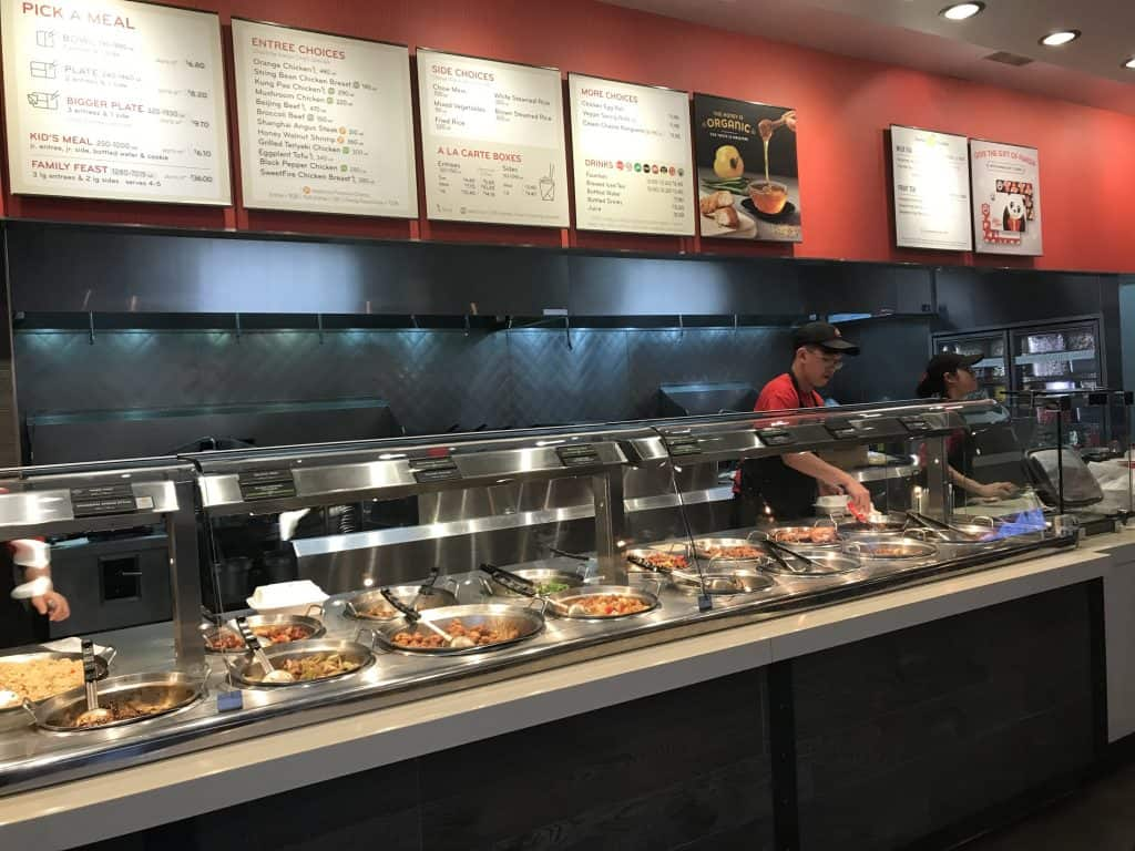 Panda Express employees making a bowl inside the restaurant