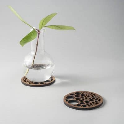 Bubbles drinks coasters in genuine walnut, geometry, circle packing