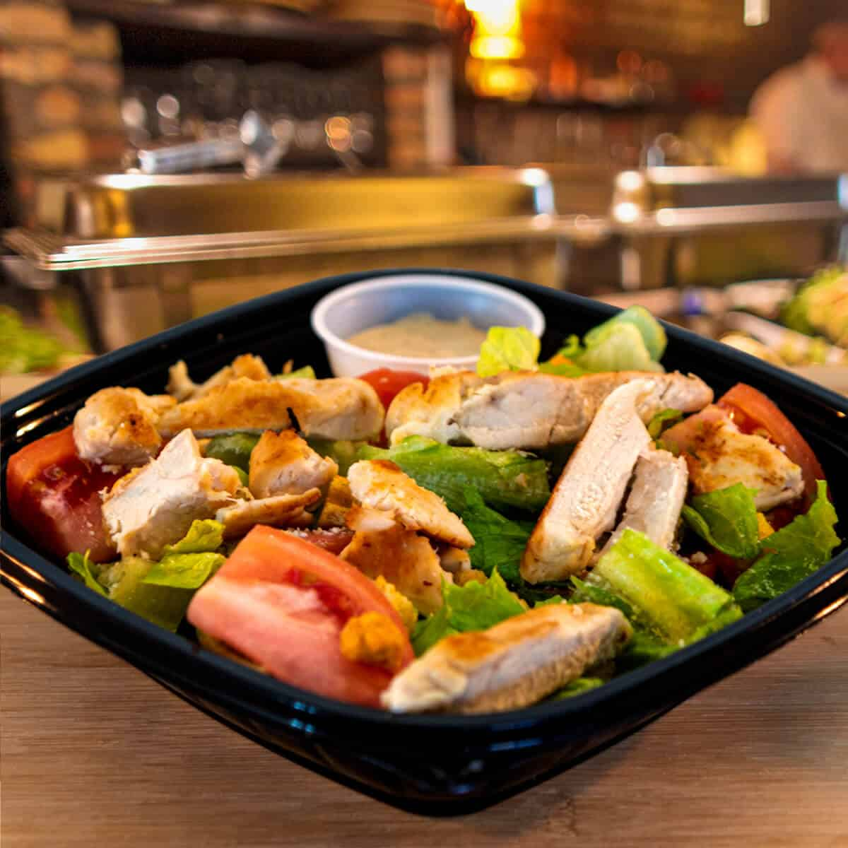 Chicken, lettuce, tomatoes and a creamy Caesar dressing