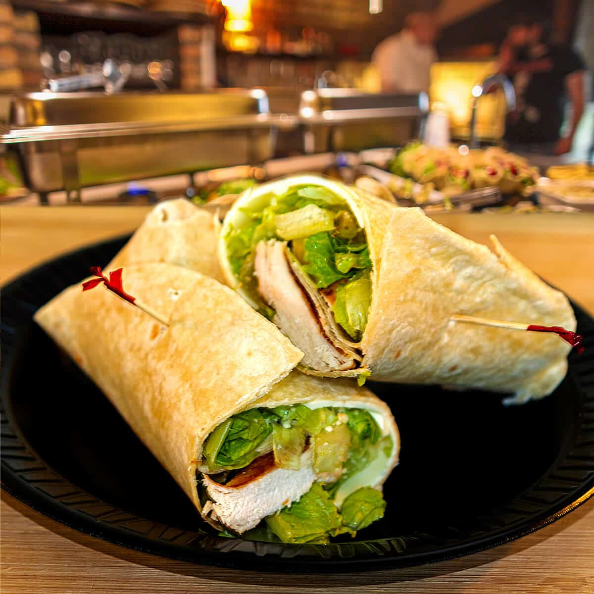 Chicken and lettuce in a wrap with dressing