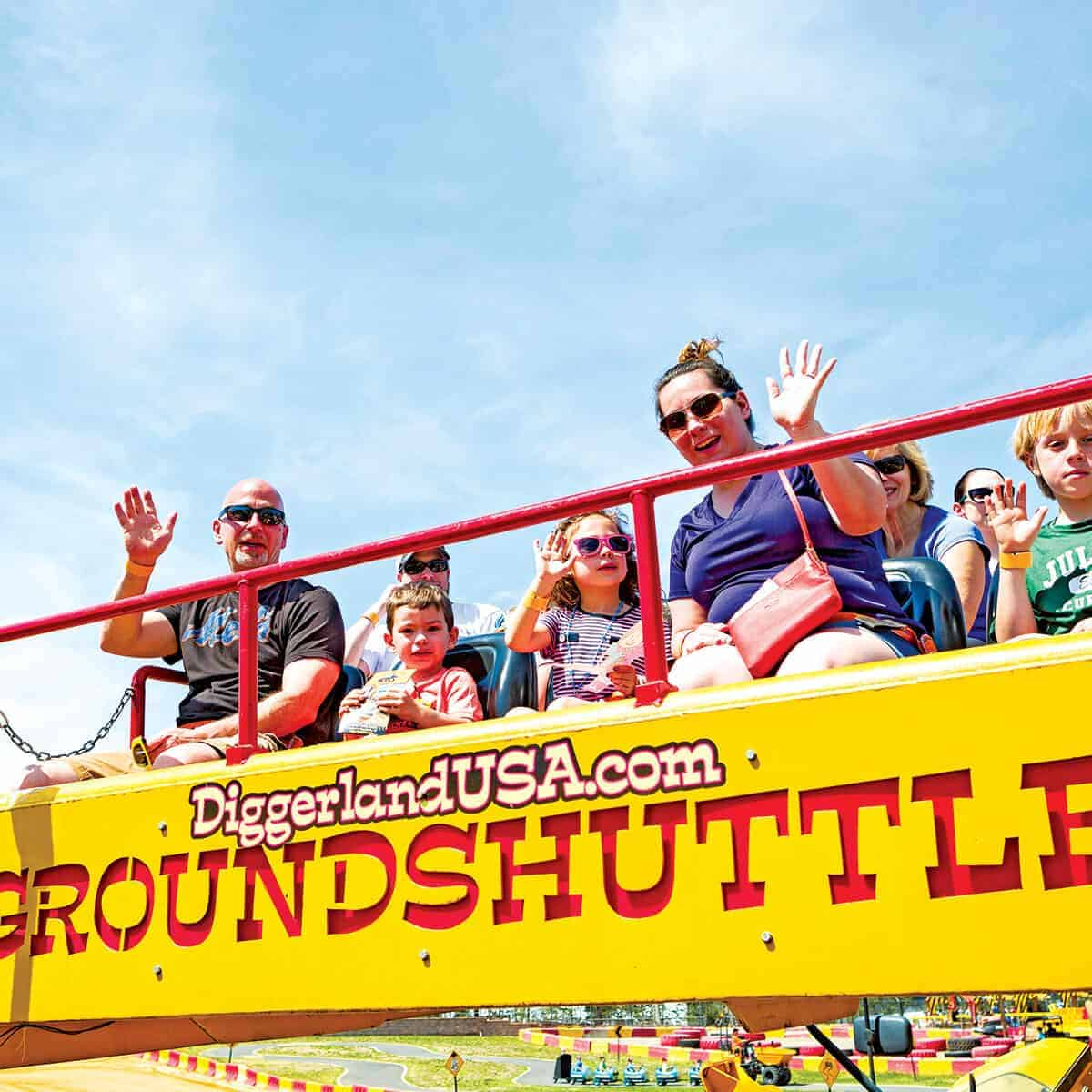 Groundshuttle ride with family waving and smiling