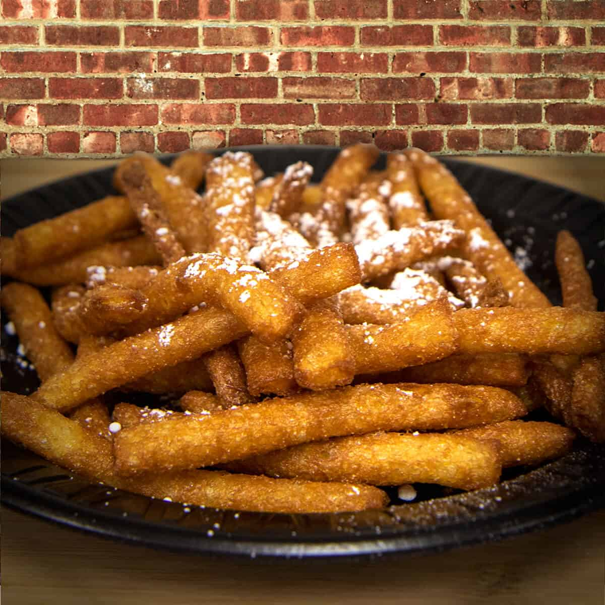 Funnel cake fries sprinkled with powdered sugar