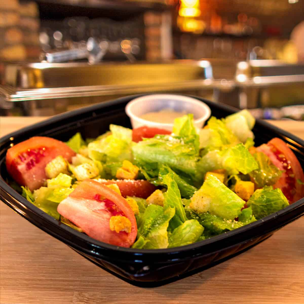 Garden salad with lettuce, tomatoes and croutons.