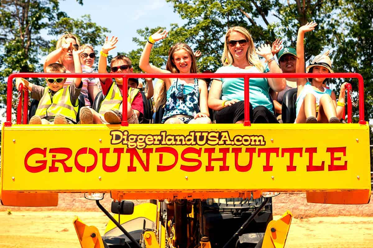 Family riding the Ground Shuttle wave for the camera