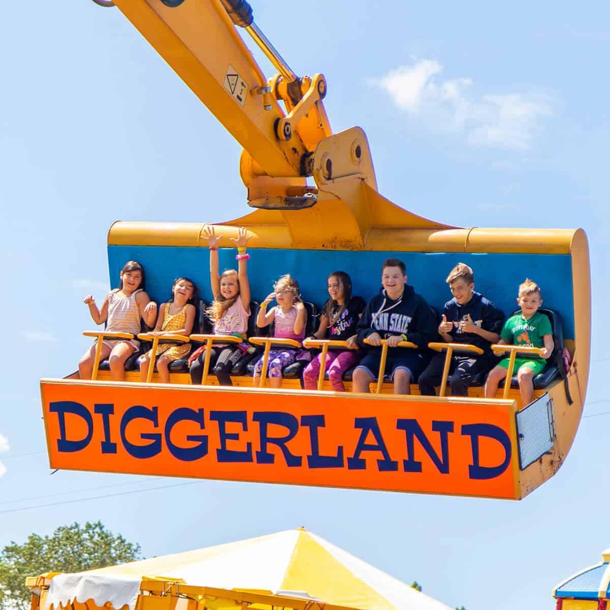 Spin dizzy ride with many happy children enjoying it