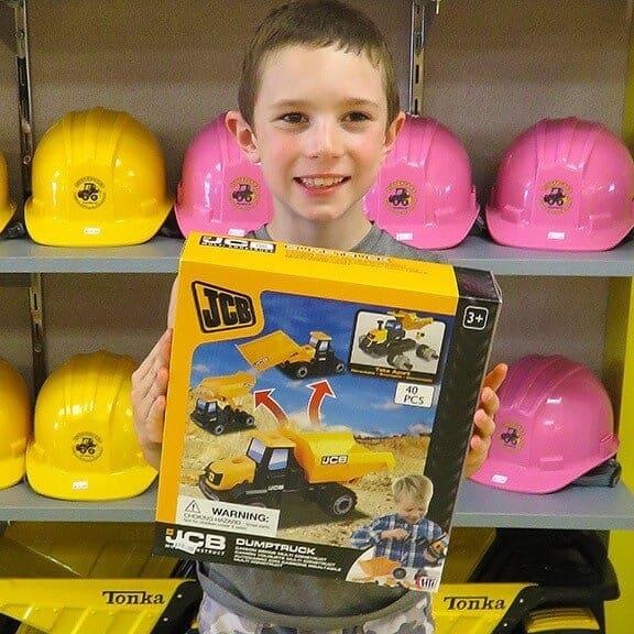 Boy holding JCB multi construct dump truck packaging