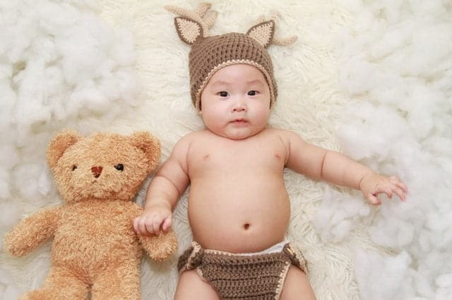 Cute Irish baby with a teddy bear