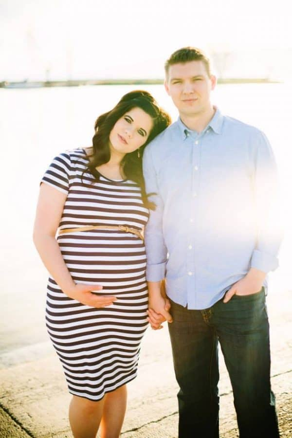 Husband and wife pose during family photos.