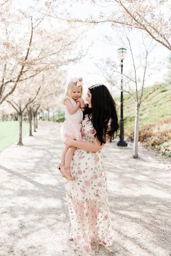 Mother and daughter pose for family photos.
