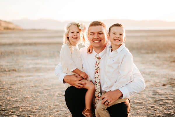 Father poses with kids for family pictures
