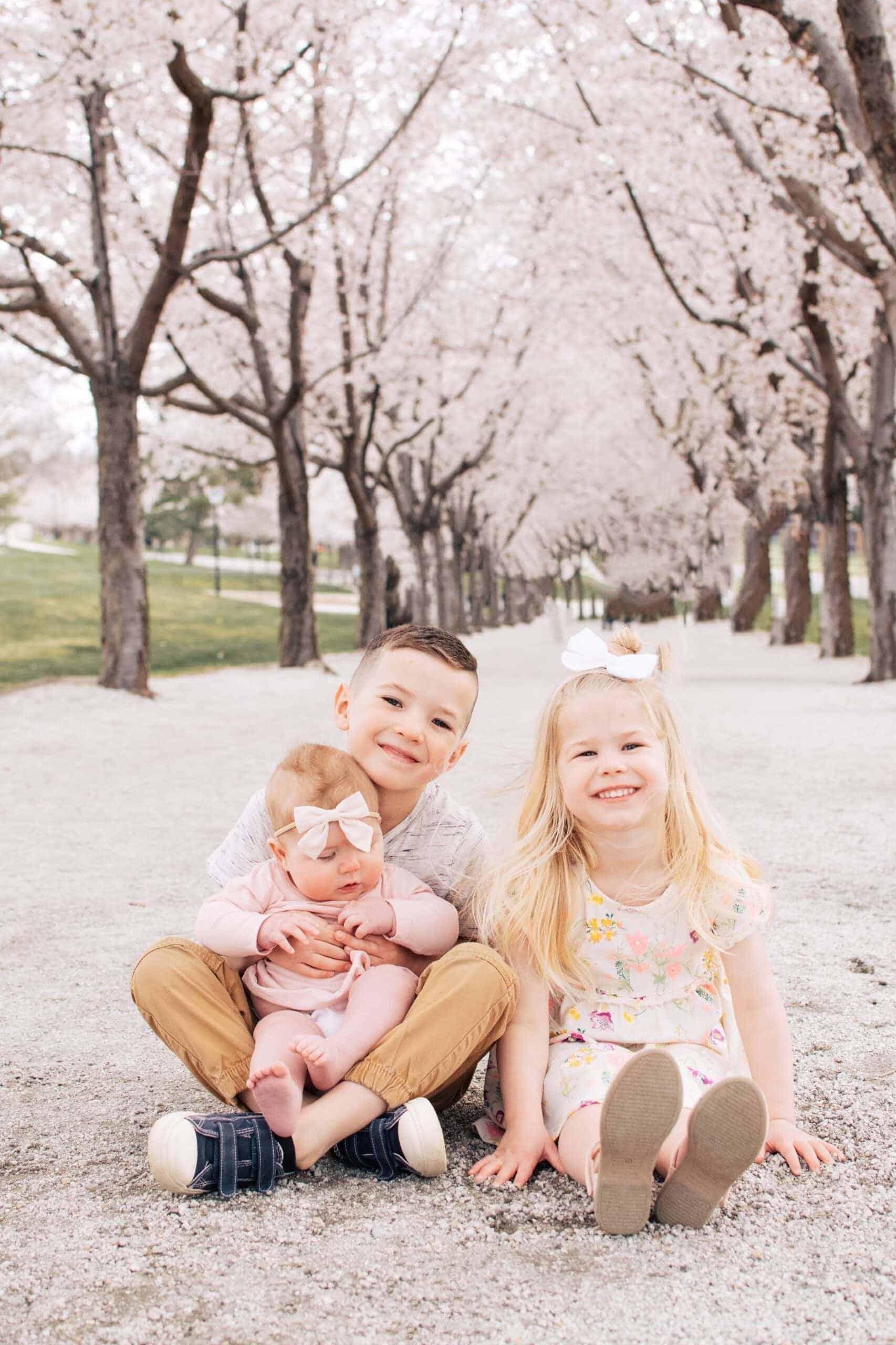 Kids smile for spring family photos.